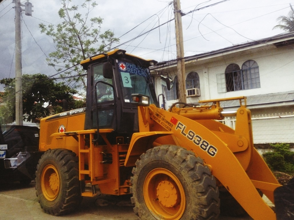 bulldozer trucks in tacloban city after typhoon yolanda