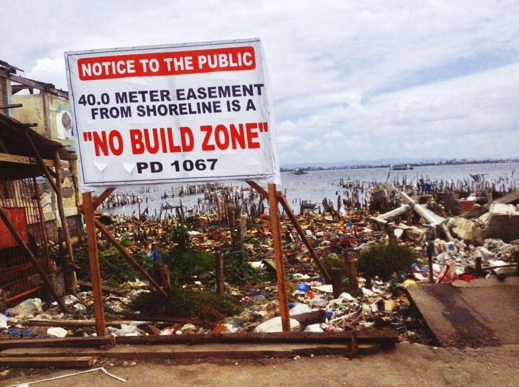 no build zone markers in tacloban city after typhoon yolanda
